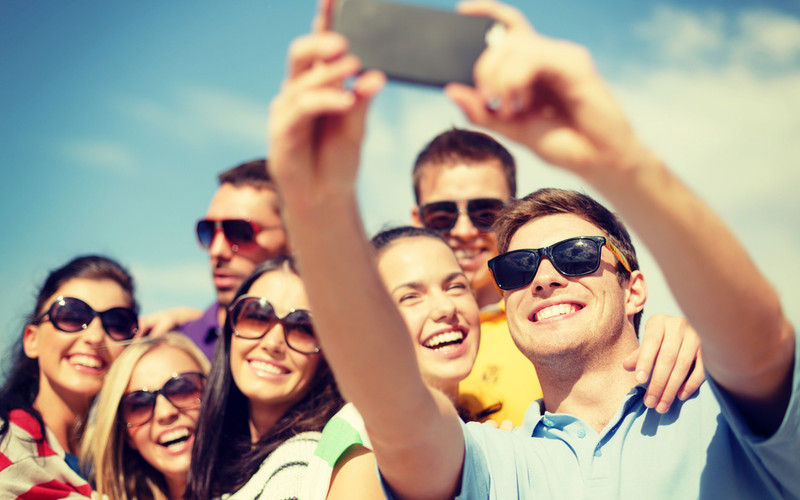 Group Of Smiling People Taking A Selfie 800x500